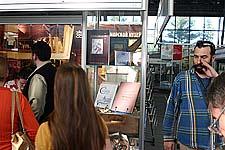 В день открытия, справа один из дизайнеров стенда Вячеслав Клименков