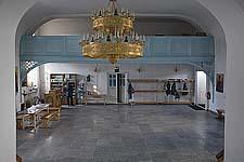 Илл. 17. Интерьер трапезной. Вид на западную стену с хорами (после реставрации)